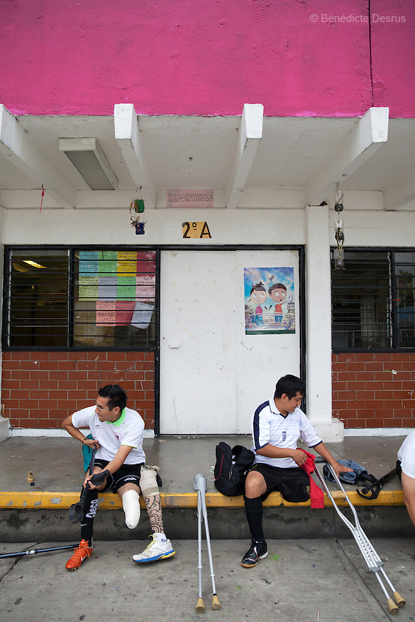 "Players from Guerreros Aztecas, remove their prosthetic leg and get changed before training in Mexico City, Mexico on June 26, 2014. Guerreros Aztecas (""Aztec Warriors"") is Mexico City's first amputee football team. Founded in July 2013 by five volunteers, they now have 23 players, seven of them have made the national team's shortlist to represent Mexico at this year's Amputee Soccer World Cup in Sinaloa this December. The team trains twice a week for weekend games with other teams. No prostheses are used, so field players missing a lower extremity can only play using crutches. Those missing an upper extremity play as goalkeepers. The teams play six per side with unlimited substitutions. Each half lasts 25 minutes. The causes of the amputations range from accidents to medical interventions – none of which have stopped the Guerreros Aztecas from continuing to play. The players' age, backgrounds and professions cover the full sweep of Mexican society, and they are united by the will to keep their heads held high in a country where discrimination against the disabled remains widespread. (Photo by Bénédicte Desrus)"