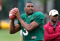TALLAHASSEE, FLA. 3/26/11-FSU032611 CH-EJ Manuel, left, works with Quarterbacks Coach Dameyune Craig during practice Saturday in Tallahassee..COLIN HACKLEY PHOTO