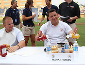 "Mark Thomas prepares his hotdogs with ketchup and mustard during the Bright Leaf Hotdog Eating Conest on Sunday, July , 2011. ""I've been training for this all my life,"" said Thomas. Photo by Al Drago."