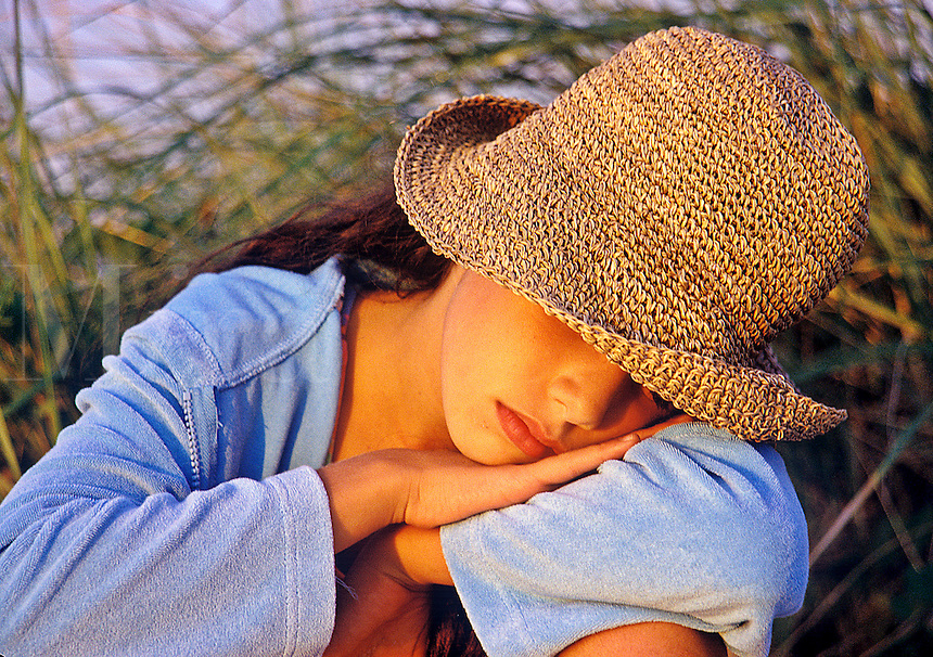Young girl resting at the beach.