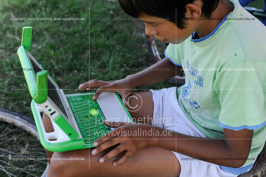 URUGUAY Salto, OLPC One Laptop per Child project, the 100 Dollar laptop initiative of Nicholas Negroponte, is implemented in Uruguay for children at all schools under Plan Ceibal, laptops also have access to the internet, boys playing games / URUGUAY Salto, fuer alle Kinder an  staatlichen Schulen Uruguays ist das OLPC one laptop per child Programm als Bildungsinitiative Plan Ceibal umgesetzt , jedes Kind bekommt einen 100 Dollar Laptop XO-1 und Zugang zum W-lan Netz der Schule, Jungen spielen Ballerspiele