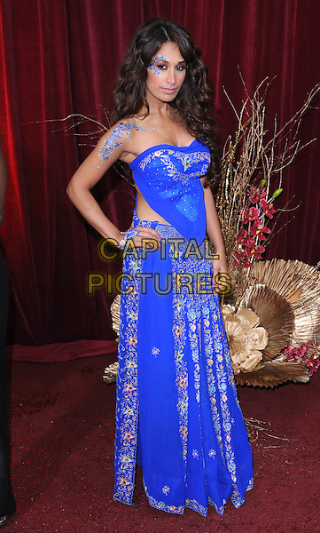 PREEYA KALIDAS.Arrivals at the British Soap Awards 2010, London Television Centre, London, England..May 8th, 2010.full length Indian dress blue strapless top long maxi skirt hand on hip tattoos jewels body art paint face make-up hand embroidered floral print patterned pattern .CAP/BEL.©Tom Belcher/Capital Pictures.
