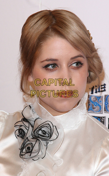 PEACHES GELDOF .Attending the South Bank Show Awards at the Dorchester Hotel, Park Lane, London, UK, January 26th 2010..arrivals portrait headshot white rosette shirt blouse corsage silk satin flowers roses ruffle hair up make-up .CAP/ROS.©Steve Ross/Capital Pictures.