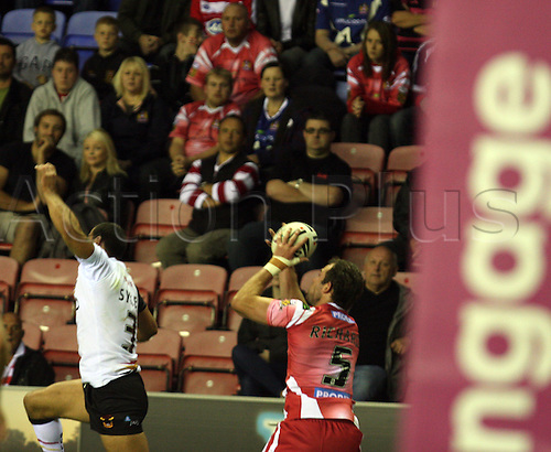 19.08.2011 Engage Super League Rugby from the DW Stadium. Wigan v Bradford. The ball is lofted in the air and caught by Pat Richards who goes on to score a try