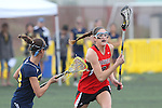 Santa Barbara, CA 02/18/12 - Lisa Riondet (Georgia #8) and Kelsey Martin (Michigan #13) in action during the Georgia-Michigan matchup at the 2012 Santa Barbara Shootout.  Georgia defeated Michigan 12-10.