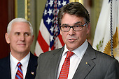 Former Governor Rick Perry (Republican of Texas), right, makes remarks after being sworn-in to be United States Secretary of Energy by US Vice President Mike Pence, left, on March 2, 2017 in Washington, DC. <br /> Credit: Olivier Douliery / Pool via CNP