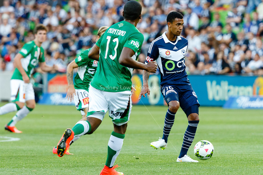 Rashid MAHAZI of the Victory passes the ball in round 12 A-League match between Melbourne Victory and Newcastle Jets at AAMI Park in Melbourne, Australia during the 2014/2015 Australian A-League season. Melbourne def Newcastle 1-0