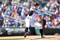 Charlotte Knights pitcher Brian Clark (17) delivers a pitch during a game against the  Gwinnett Braves at BB&T Ballpark on May 7, 2017 in Charlotte, North Carolina. The Knights defeated the Braves 7-1. (Tony Farlow/Four Seam Images)