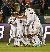 CARSON, CA – May 14, 2011: LA Galaxy team celebrates midfielder David Beckham's (23) goal during the match between LA Galaxy and Sporting Kansas City at the Home Depot Center in Carson, California. Final score LA Galaxy 4, Sporting Kansas City 1.