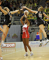 09.07.2011 England's Pamela Cookey in action during the netball match between Silver Ferns and England at the Mission Foods World Netball Championship 2011 held at the Singapore Indoor Stadium in Singapore . Mandatory Photo Credit ©Michael Bradley.