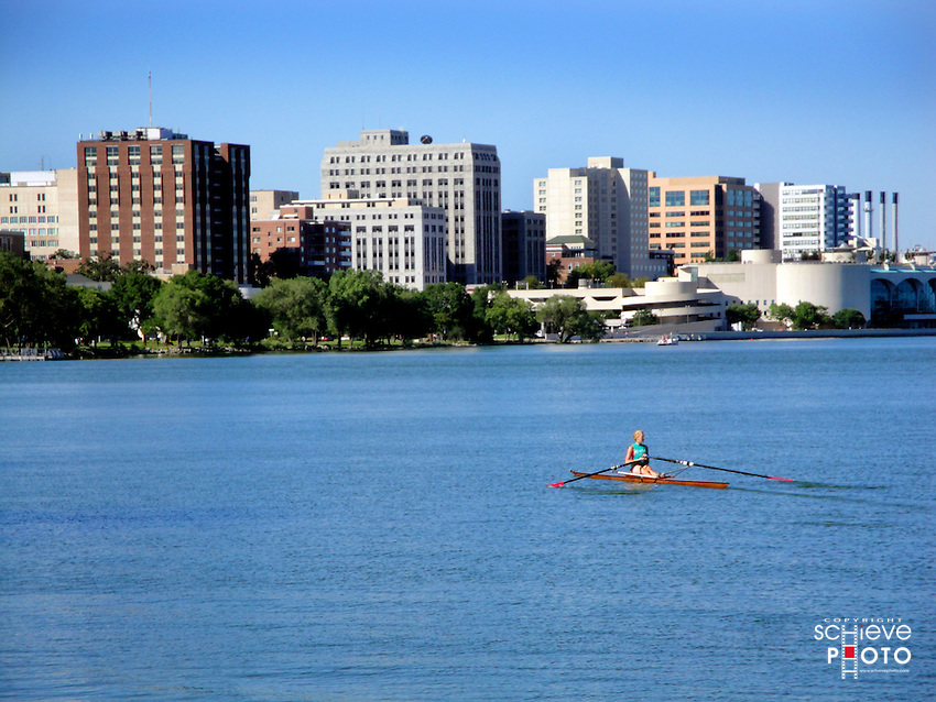 A woman in a single crew boat on Madison, Wisconsin's Lake Monona.