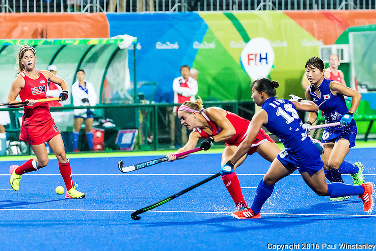 Alyssa Manley #29 of United States passes before Yukari Mano #13 of Japan can stop her during USA vs Japan in a Pool B game at the Rio 2016 Olympics at the Olympic Hockey Centre in Rio de Janeiro, Brazil.