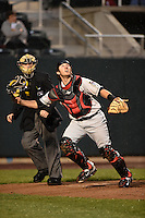 New Britain Rock Cats catcher Matt Koch (22) looks for a pop up in front of umpire Junior Valentine during a game against the Harrisburg Senators on April 28, 2014 at Metro Bank Park in Harrisburg, Pennsylvania.  Harrisburg defeated New Britain 9-0.  (Mike Janes/Four Seam Images)
