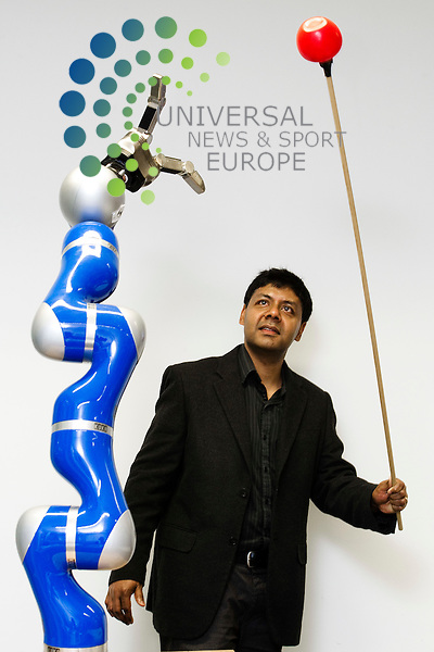 Professor Sethu Vijayakumar, Director of Institute of Perception, Action and Behaviour at the School of Informatics, University of Edinburgh with a mini robot dance troup that promises to be one of the hits of this year's Edinburgh International Festival, Edinburgh, Scotland, 3rd April, 2012. Pictured the professor with a robotic device that can detect and capture a redball..Picture:Scott Taylor Universal News And Sport (Europe) .All pictures must be credited to www.universalnewsandsport.com. (Office)0844 884 51 22.