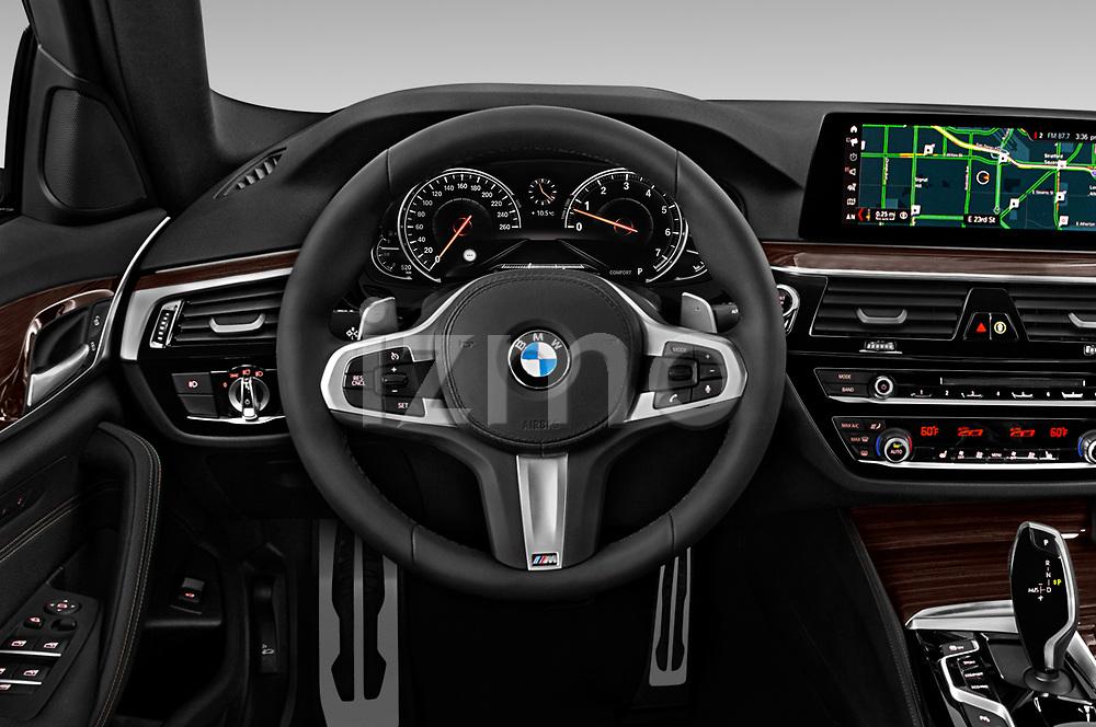 Car pictures of steering wheel view of a 2019 BMW 5-Series M-Sport 4 Door Sedan Steering Wheel
