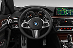 Car pictures of steering wheel view of a 2019 BMW 5-Series M-Sport 4 Door Sedan Steering Wheel