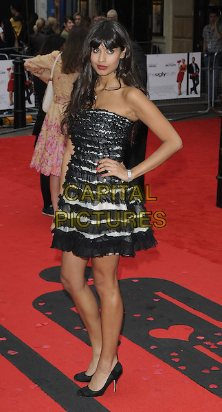 "JAMEELA JAMIL.The UK film premiere of ""The Ugly Truth""  held at the Vue West End, Leicester Square, London, England..August 4th 2009.full length black grey gray tulle tiered strapless dress hand on hip.CAP/CAN.©Can Nguyen/Capital Pictures."