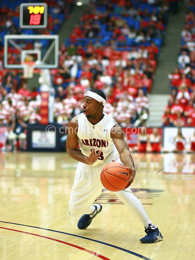 Jan 10, 2009; Tucson, AZ, USA; Arizona Wildcats guard Nic Wise (13) dribbles the ball beyond the arc in the second half of a game against the Oregon State Beavers at the McKale Center.  The Wildcats won the game 64-47.