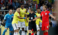 MOSCU - RUSIA, 03-07-2018: David OSPINA, arquero, Radamel FALCAO GARCIA, Yerry MINA,  jugadores de Colombia discute con Mark Geiger (USA), arbitro,   durante partido de octavos de final entre Colombia y Inglaterra por la Copa Mundial de la FIFA Rusia 2018 jugado en el estadio del Spartak en Moscú, Rusia. / David OSPINA, goalkeeper, Radamel FALCAO GARCIA, Yerry MINA, players of Colombia discuss  with Mark Geiger (USA), referee, during the match between Colombia and England of the round of 16 for the FIFA World Cup Russia 2018 played at Spartak stadium in Moscow, Russia. Photo: VizzorImage / Julian Medina / Cont
