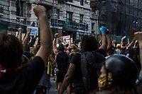 NEW YORK, NEW YORK - June 7: Protesters raise their arms during a march alongside Central Park on June 7, 2020 in New York, NY. Protesters continue to take to the streets across the United States and other parts of the world after the murder of George Floyd by a white police officer Derek Chauvin. The protests attempt to give voice to the need for African American human rights. (Photo by Pablo Monsalve / VIEWpress )