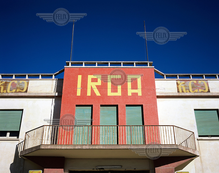 Entrance to the former IRGA factory. Asmara is a showcase of 1930s Italian Art Deco architecture. Initially created by colonial-era Italians, the style continued to flourish in the 1960s as local architects carried on the tradition.