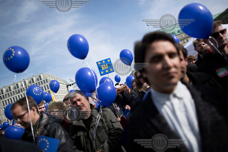 People with EU flag balloons at a pro-EU rally, the 'March for Europe', organised by the European Movement to celebrate the 60th anniversary of the Treaty of Rome.