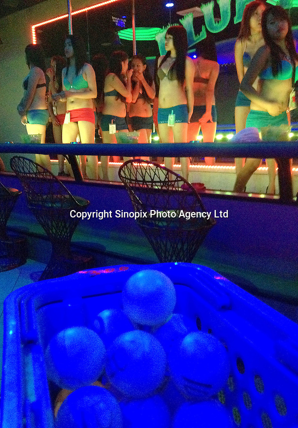 Ping pong balls are seen with dancing prostitutes in the Blue Flame bar in Angeles City, Republic of the Philippines, 08 November 2014. The 'sin city', which sprung up on the fringes of a US Air Force base during the Vietnam war, has a reputation for cheap sex, and was a favourite destination for alleged murderer Rurik Jutting, who used to fly to Angeles City from Hong Kong for debauched weekends. The British banker is currently on remand at a secure facility in Hong Kong for allegedly murdering two Indonesian prostitutes in his flat whilst high on alcohol and cocaine.