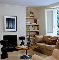 Bronze sculptures and other artworks are used to decorate this contemporary living room