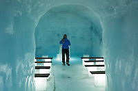 "Langjokull, Iceland - A woman stands at an ice chapel inside Langjokull glacier, Iceland, March 2016. Langjokull (Icelandic for ""long glacier"") is the second largest ice cap in Iceland (953 km2), after Vatnajokull. It is situated in the west of the Icelandic interior or Highlands of Iceland."
