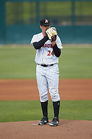 Kannapolis Intimidators starting pitcher Blake Battenfield (24) looks to his catcher for the sign against the Lakewood BlueClaws at Kannapolis Intimidators Stadium on April 8, 2018 in Kannapolis, North Carolina.  The Intimidators defeated the BlueClaws 4-3 in game two of a double-header.  (Brian Westerholt/Four Seam Images)