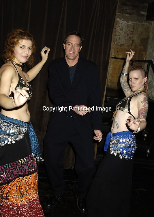 Robert Bogue and The Belly dancers..at the 30th Anniversary Party for Soap Opera Digest on ..November 17, 2005 at PM Lounge. ..Photo by Robin Platzer, Twin Images