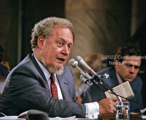 Judge Robert H. Bork, United States President Ronald Reagan's nominee for Associate Justice of the U.S. Supreme Court, holds a copy of the U.S. Constitution as he testifies before the U.S. Senate Judiciary Committee during his confirmation hearing on September 16, 1987.  Bork passed away on December 19, 2012..Credit: Ron Sachs / CNP