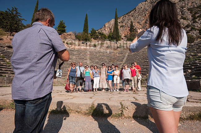 Tourists photograph one another for memory, Amphitheater, Delphoi, Greece