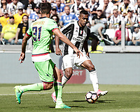 Calcio, Serie A: Juventus vs Crotone. Torino, Juventus Stadium, 21 maggio 2017.<br /> Juventus&rsquo; Alex Sandro, right, challenged by Crotone's Mario Sampirisi during the Italian Serie A football match between Juventus and Crotone at Turin's Juventus Stadium, 21 May 2017. Juventus defeated Crotone 3-0 to win the sixth consecutive Scudetto.<br /> UPDATE IMAGES PRESS/Isabella Bonotto