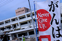 "A sign reads ""ganbare""  - never give up - in Minamisanriku, Myiagi, Japan. The fishing port of Minamisanriku, Miyagi, Japan was devastated by the tsunami where the popultion was reduced from 18,000 to about 8,000."