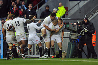 Players celebrate Chris Ashton's try. QBE International match between England and New Zealand on December 1, 2012 at Twickenham Stadium in London, England. Photo by: Patrick Khachfe / Onside Images