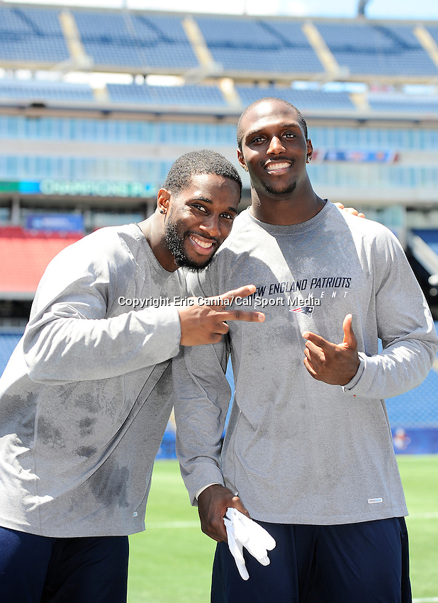 MAY 24 2012  New England Patriots defensive back Kyle Arrington #24 and New England Patriots defensive back Devin McCourty #32 take a light hearted moment to pose for a photo inside Gillette Stadium before being interviewed by the media. Arrington and McCourty participated in the Patriots OTA's held earlier on the Patriots practice fields...