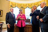 Attorney General Jeff Sessions (L) smiles while Sessions' wife, Mary Blackshear Sessions (C-L), U.S. President Donald J. Trump (C-R), and Vice President Mike Pence (R) clap after he was sworn-in as attorney general in the Oval Office of the White House in Washington, DC, USA, 09 February 2017. On 08 February, after a contentious battle on party lines, the Senate voted to confirm Sessions as attorney general.<br /> Credit: Jim LoScalzo / Pool via CNP