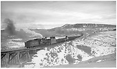 Westbound freight at Cerro Summit with #454 pushing.<br /> D&amp;RGW  Cerro Summit, CO  Taken by Perry, Otto C. - 11/26/1942