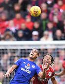 4th November 2017, Ashton Gate, Bristol, England; EFL Championship football, Bristol City versus Cardiff City; Lee Peltier of Cardiff City and Bobby Reid of Bristol City compete in the air