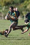 David Raikuna dances past wouldbe Drury tacklers. Counties Manukau Premier Club rugby game between Drury & Pukekohe played at the Drury Domain on Saturday May 23rd 2009..Pukekohe won the game 23 - 11 after laeding 16 - 11 at halftime.