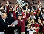 Florida State head coach Jimbo Fisher gets emotional after winning the BCS national title game at the Rose Bowl in Pasadena, California on January 6, 2014.  Fisher's wife, Candi and son Trey look on.  Florida State Seminoles defeated the Auburn Tigers 34-31.