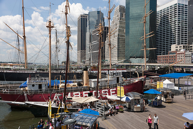 Ambrose light ship and other vintage ships docked at the South Street Seaport Museum in New York City
