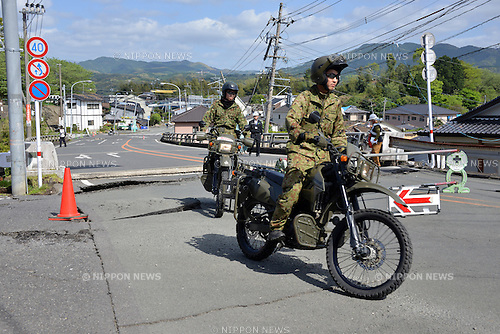 April 17, 2016, Kumamoto, Japan - Ground Self Defense Force rangers patrol with motorcycles at Mashiki town in Kumamoto prefecture on Sunday, April 17, 2016. More than 40 people died and some 1,000 injured as massive earthquakes attacked Japan's southern island of Kyushu. (Photo by Yoshio Tsunoda/AFLO) LWX -ytd-