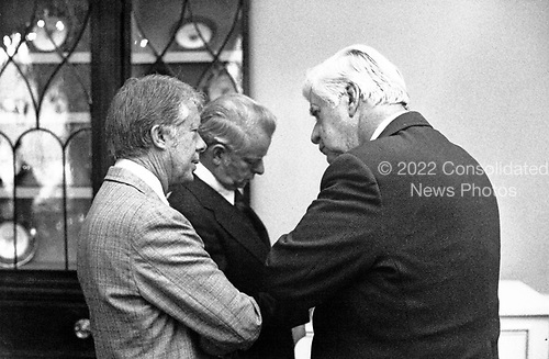 "United States President Jimmy Carter talks with the Speaker of the US House of Representatives Thomas P. ""Tip"" O'Neill (Democrat of Massachusetts) and US Senate Majority Leader Robert Byrd (Democrat of West Virginia) following the Democratic Congressional Leadership Breakfast in the first floor Private Dining Room of the White House in Washington, DC on January 25, 1977.<br /> Credit: White House via CNP"