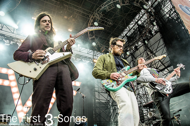 Brian Bell, Rivers Cuomo and Scott Shriner of Weezer performs at White River State Park in Indianapolis, Indiana.