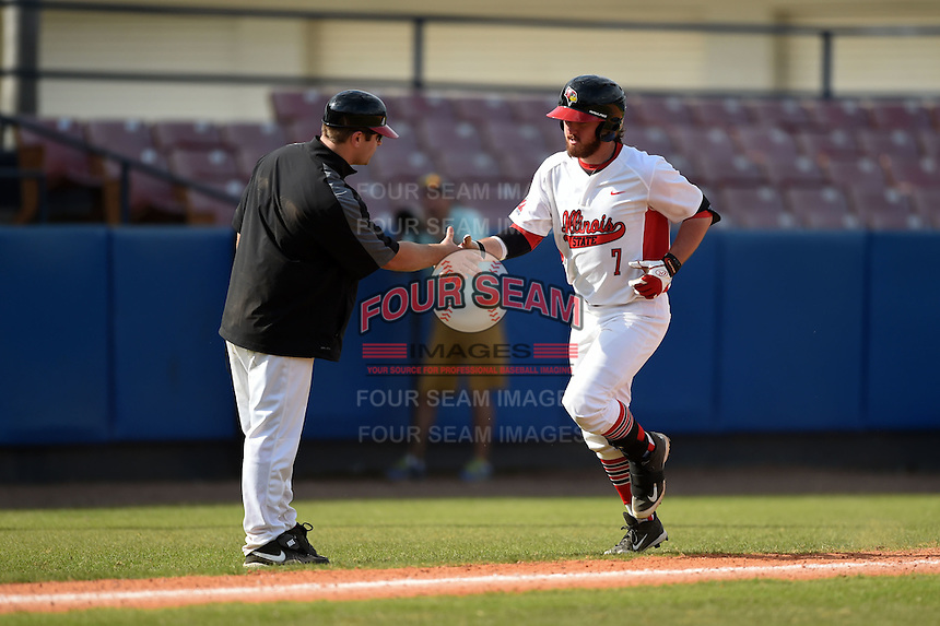 Illinois State Redbirds Mason Snyder (7) shakes hands with coach Mike Stalowy while running the bases after hitting a home run during a game against the Bowling Green Falcons on March 11, 2015 at Chain of Lakes Stadium in Winter Haven, Florida.  Illinois State defeated Bowling Green 8-7.  (Mike Janes/Four Seam Images)