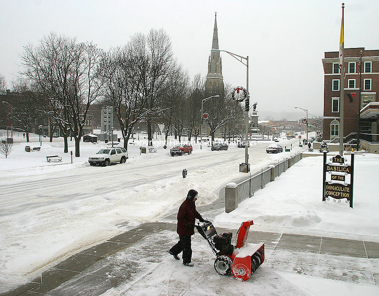 WATERBURY, CT. 23 JANUARY 29_NEW_012809DA03.jpg-Kyle VanWagner plows the sidewalk in front of The Basilica of the Immaculate Conception in Waterbury during Wednesday's storm.<br />  Darlene Douty