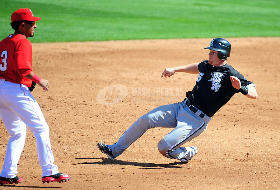 Mar. 6, 2012; Tempe, AZ, USA; Chicago White Sox base runner Gordon Beckham slides into second with a stolen base in the third inning against the Los Angeles Angels during a spring training game at Tempe Diablo Stadium.  Mandatory Credit: Mark J. Rebilas-