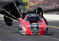 Sept. 19, 2010; Concord, NC, USA; NHRA funny car driver Cruz Pedregon slows down from deployed parachutes during the O'Reilly Auto Parts NHRA Nationals at zMax Dragway. Mandatory Credit: Mark J. Rebilas-